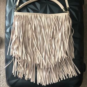 Fringe cross body bag with arm handle as well.